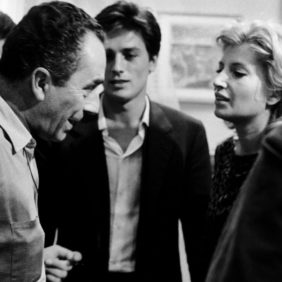 Michelangelo Antonioni and the actors.